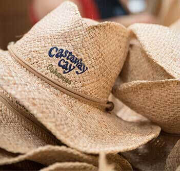 Castaway Cay logo on the front of straw hats