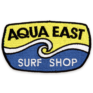 Aqua East Surf Shop with blue and yellow waves patch